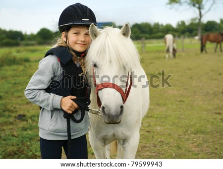 Portrait of little girl with her pony