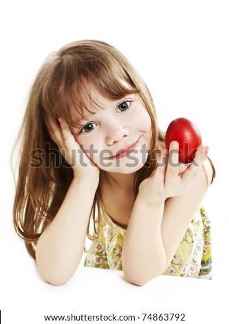Portrait of little girl with red Easter egg - stock photo