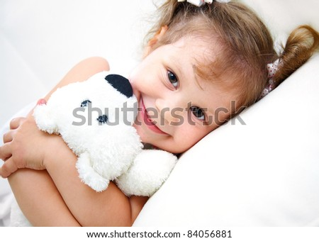 Portrait of little girl with teddy bear on white background