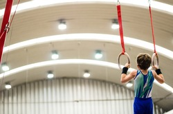 Portrait of little kid gymnast in a championship.
