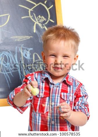 Portrait of llittle boy is drawing on a blackboard. Isolated on white background