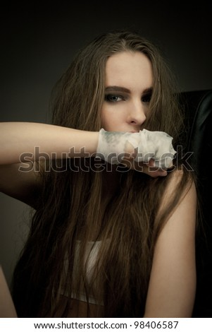 Portrait of long hair beauty with hand wrapped with a bandage like boxer