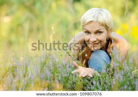 portrait of look well smiling middle aged woman outdoors