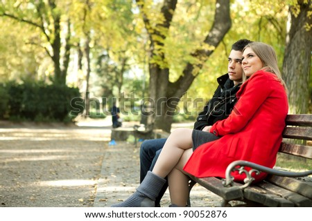 Portrait of love couple enjoying themselves in park,  outdoor