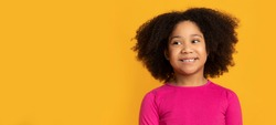 Portrait of lovely african american kid, little girl smiling over yellow background, panorama with free space