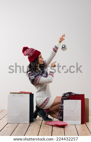 Portrait of lovely christmas woman with shopping bags and christmas decoration #224432257