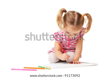 Portrait of lovely girl holding a pencil. drawing in copybook. shooting in the studio on white background.