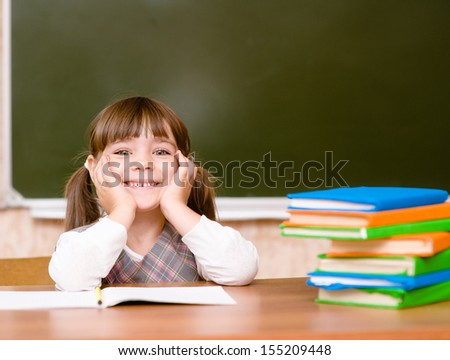 Portrait of lovely girl in classroom.