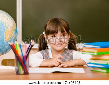 Portrait of lovely girl in classroom