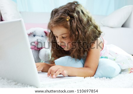Portrait of lovely girl typing on laptop