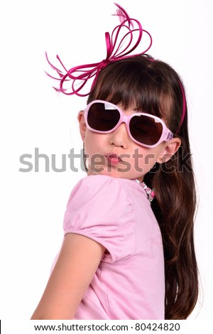 Portrait of lovely girl wearing pink dress and glasses, blowing a kiss, isolated on white background