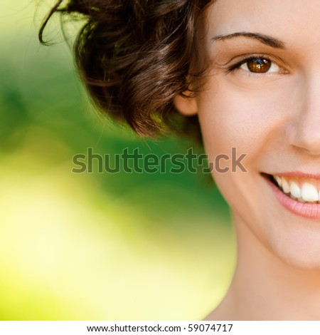 Portrait of lovely smiling girl, on green background.