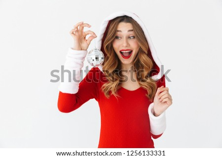 5a4da651fea18 Portrait of lovely woman 20s wearing Santa Claus red costume smiling and  holding Christmas tree ball