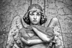 Portrait of loving angel on marble, monumental cemetery of Genoa, Italy, one of the most important monumental cemeteries in Europe.