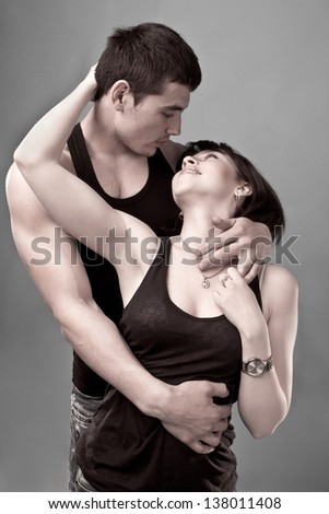 portrait of loving couple on the gray background