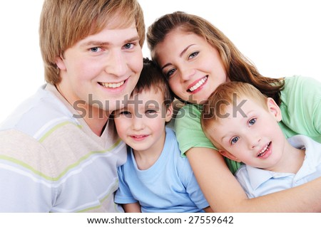 portrait of loving happy young family with two sons