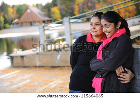 portrait of loving mother and daughter in outdoors - stock photo