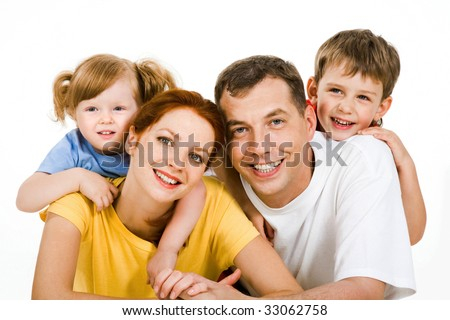 Portrait of lying couple with children on their back