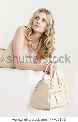 Lifestyle - Pagina 5 Stock-photo-portrait-of-lying-woman-wearing-summer-clothes-with-a-handbag-77703178