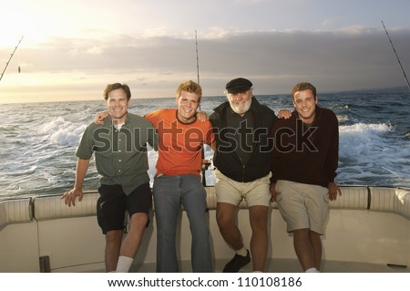 Portrait of male Caucasian friends on yacht