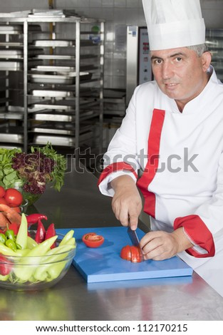 portrait of male chef in kitchen