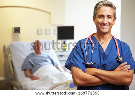 Portrait Of Male Doctor With Patient In Background