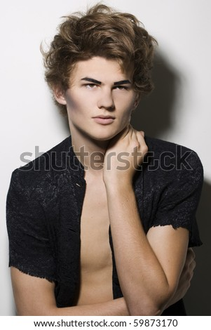 Portrait of male fashion model with stylish hairstyle and makeup