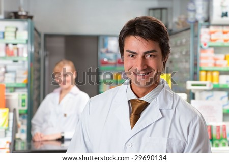 portrait of male pharmacist looking at camera and smiling