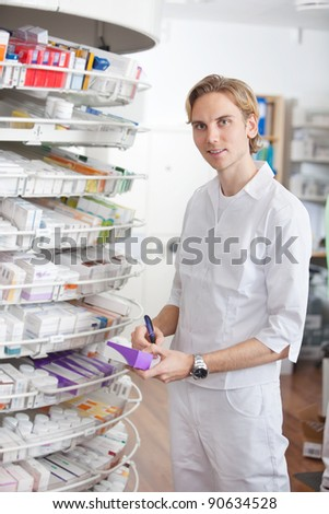Portrait of male pharmacist working at drugstore