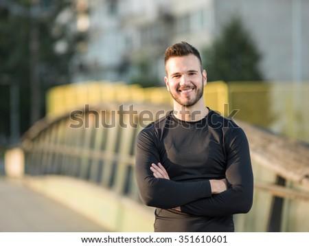Portrait Of Male Runner On Urban Street