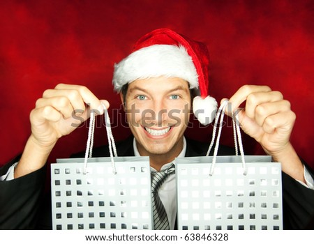 Portrait of male with present gift shopping bags