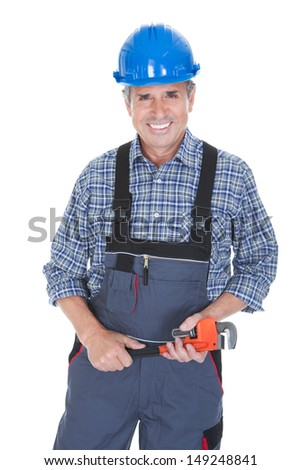 Portrait Of Male Worker Holding Wrench Over White Background - stock photo