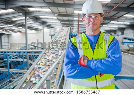 Portrait Of Male Worker In Waste Recycling Plant