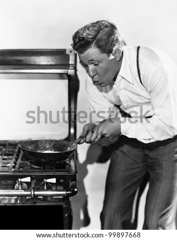 Portrait of man cooking on stove