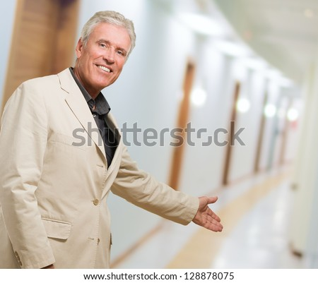 Portrait Of Man Doing A Welcome Gesture, indoor