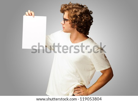 Portrait Of Man Holding A Blank Paper Isolated On Grey Background