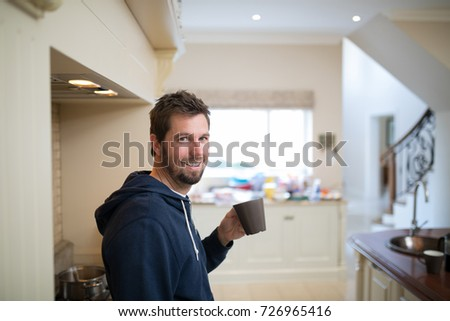 portrait of man holding a cup...
