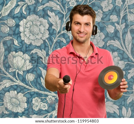 Portrait of man holding mike and disc, wallpaper