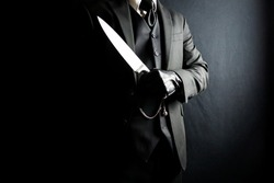 Portrait of Man in Dark Suit and Leather Gloves Holding Sharp Knife. Stylish Gentleman Who Will Cut You. Mafia Hitman.