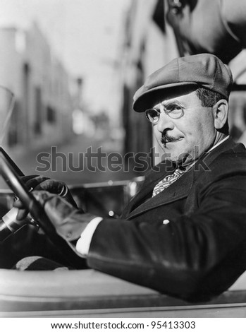 Portrait of man in drivers seat of car