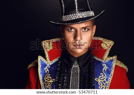 Portrait of man in expensive suit of illusionist-conjurer. Fashion photo.