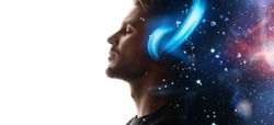 Portrait of man in headphones listening music with closed eyes. Double exposure of male face and galaxy isolated on white background. Digital art. The universe inside us.