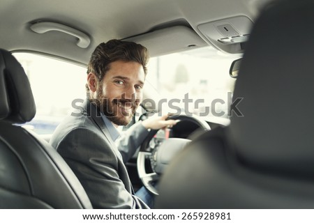 Portrait of man in his car. looking camera #265928981