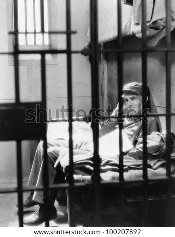 Portrait of man in jail
