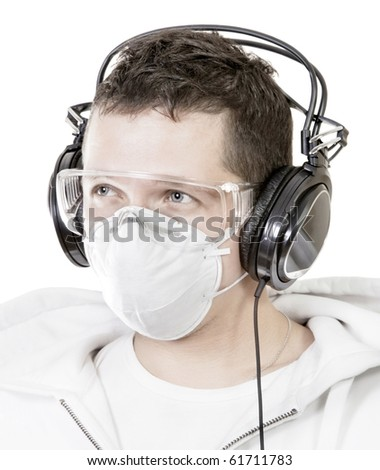 Portrait of man in mask listening music