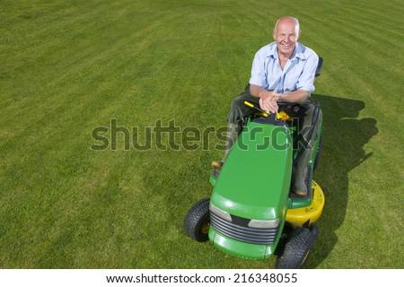 Portrait of man on riding lawn mower