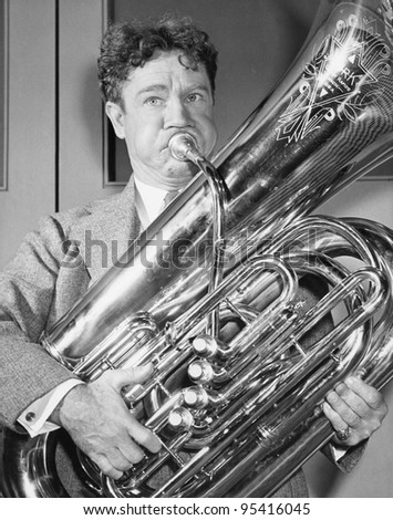 Portrait of man playing tuba