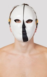 Portrait of man wearing mask against gray background