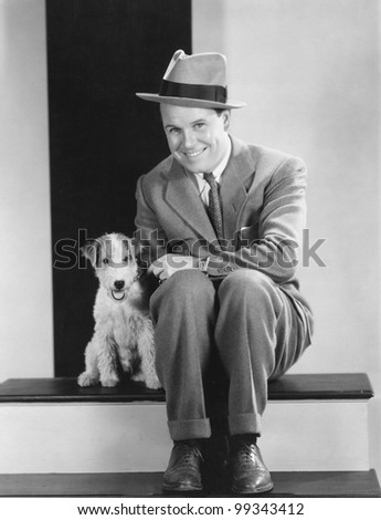 Portrait of man with puppy
