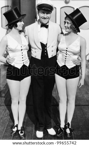 Portrait of man with two women wearing top hats